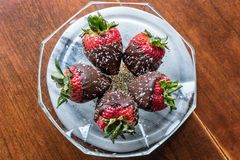 A delicious plate of Chocolate Covered Strawberries stock photo
