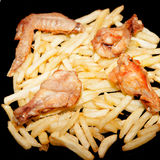 Delicious plate of fries with wings Stock Photos