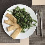 A delicious plate of salmon crepes and salad dripped with balsam for Maslenitsa in Ukraine. In Slavic mythology, Maslenitsa is a sun-festival, personified by the royalty free stock photo