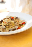 Delicious plate of spaghetti vongole. Fresh serving of spaghetti with clams on a sunny day Stock Images