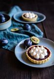Delicious plum meringue tartlets royalty free stock images