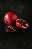 Delicious pomegranate fruit on the black background Royalty Free Stock Photography