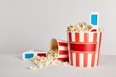 Popcorn in striped buckets with 3d