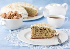 Delicious poppy seed cake with cup of tea on table Royalty Free Stock Photography