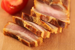Delicious pork belly meat with tomatoes Royalty Free Stock Images