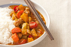 Delicious pork curry and chopstickclose up Royalty Free Stock Photo