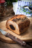 Delicious pork loin with plum. Royalty Free Stock Photo