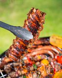 Delicious pork spareribs on grill grate Royalty Free Stock Image