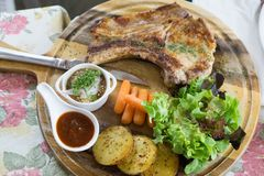 Delicious Pork Steak with organic salad royalty free stock photography