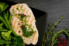 Delicious portion of chicken breast with steamed vegetables Royalty Free Stock Images