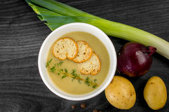 Delicious portion of cream soup with crackers Stock Photo