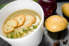 Delicious portion of cream soup with crackers. And herbs Stock Photos