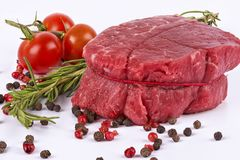 Delicious portion of fresh filet mignon. With aromatic herbs royalty free stock photography