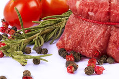 Delicious portion of fresh filet mignon. With aromatic herbs stock photography