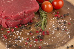 Delicious portion of fresh filet mignon. With aromatic herbs royalty free stock image