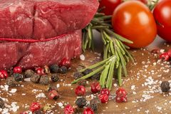 Delicious portion of fresh filet mignon. With aromatic herbs royalty free stock photos