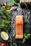 Delicious  portion of  fresh salmon fillet  with aromatic herbs, Royalty Free Stock Photo