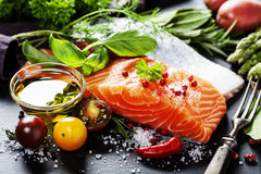 Delicious portion of fresh salmon fillet with aromatic herbs, royalty free stock photography