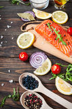 Delicious portion of fresh salmon fillet with aromatic herbs, spices and vegetables - healthy food, diet or cooking concept Stock Photos