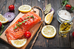 Delicious portion of fresh salmon fillet with aromatic herbs, spices and vegetables - healthy food Royalty Free Stock Photography