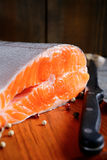 Delicious portion of fresh salmon steak slices. Cooking concept Royalty Free Stock Images