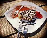 Delicious portion of tiramisu on white saucer Royalty Free Stock Images