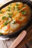 Delicious potato casserole in a pan close-up. vertical Royalty Free Stock Photos