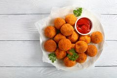 Delicious potato croquettes with tomato sauce royalty free stock photography