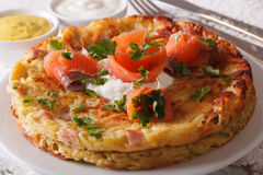 Delicious potato Fritters with salmon on a plate close-up. horiz Royalty Free Stock Photography