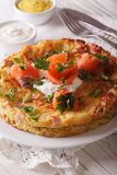 Delicious potato Fritters with salmon on a plate close-up. Verti Stock Photos