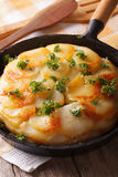 Delicious potato gratin in a pan close-up. Vertical Royalty Free Stock Photo