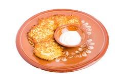 Delicious potato pancakes with sour cream. Royalty Free Stock Photos