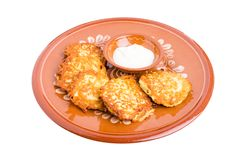 Delicious potato pancakes with sour cream. Royalty Free Stock Image