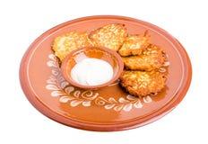 Delicious potato pancakes with sour cream. Stock Image