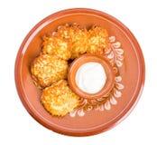 Delicious potato pancakes with sour cream. Stock Images