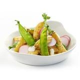 Delicious potato salad with raddish and sugarsnaps stock photos