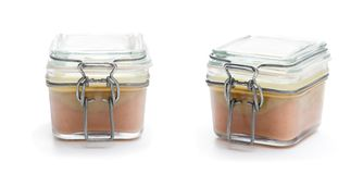 Delicious  poultry liver pate in a glass jar container isolated Royalty Free Stock Images