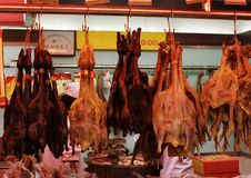 Ducks geese and chickens dried and smoked on a show-window of shop in Shanghai. Delicious poultry ready to eat Stock Images