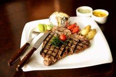 Delicious Premium T Bone Steak. Premium T Bone Steak set and photographed in a fine dining restaurant environment royalty free stock images