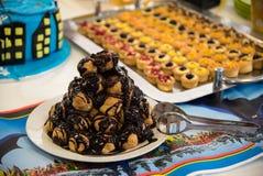 Delicious profiterole chocolate cake Stock Photos