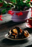 Delicious Profiterole on Wooden Table. Delicious Profiterole on Rustic Wooden Table Stock Photo
