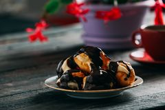 Delicious Profiterole on Wooden Table. Delicious Profiterole on Rustic Wooden Table Stock Image