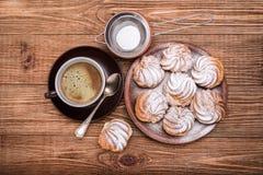 Delicious profiteroles with cream dessert. Royalty Free Stock Photo