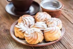 Delicious profiteroles with cream dessert. Stock Photos