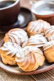 Delicious profiteroles with cream dessert. Stock Images
