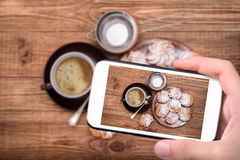 Delicious profiteroles with cream dessert. Royalty Free Stock Photography