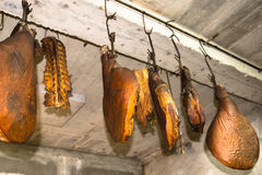 Delicious prosciutto hanging from the ceiling Royalty Free Stock Photos