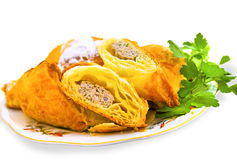Delicious puff with meat. On plate with fresh herbs Royalty Free Stock Images