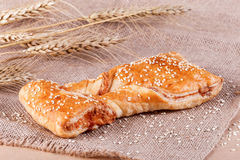 Delicious Puff pastry with cheese filling and sesame seeds Royalty Free Stock Image
