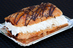 Delicious puff-pastry of cream and chocolate Royalty Free Stock Image